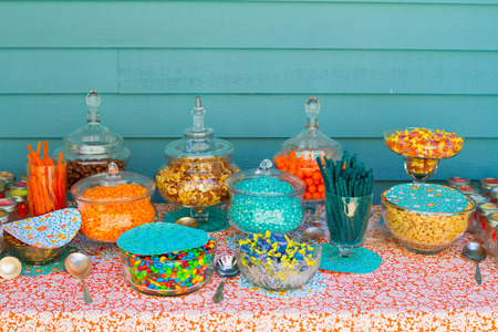 rancheros: BATTLE GROUND, WA - JULY 19, 2014: Candy bar at a wedding reception featuring licorice, Jolly Ranchers, Jelly Belly beans and chocolates.