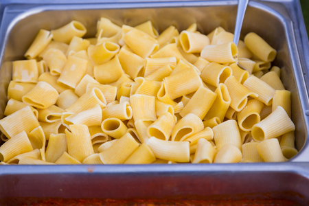 food allergies: Buffet dinner at a wedding reception includes gluten free pasta for guests with food allergies.
