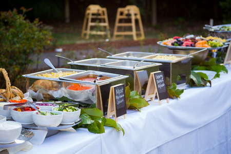 Buffet dinner at a wedding reception with pasta and toppings. Stockfoto