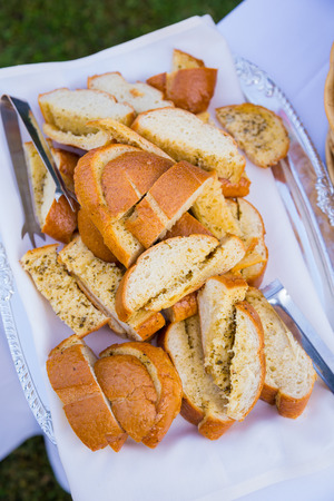 includes: Wedding reception buffet food includes this bread for dinner. Stock Photo