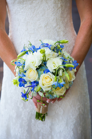 bride: Flowers in a bouquet held by the bride on her wedding day.