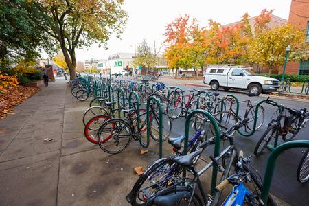 eugene: EUGENE, OR - NOVEMBER 12, 2015: Bicycles in bike racks on the University of Oregon campus.