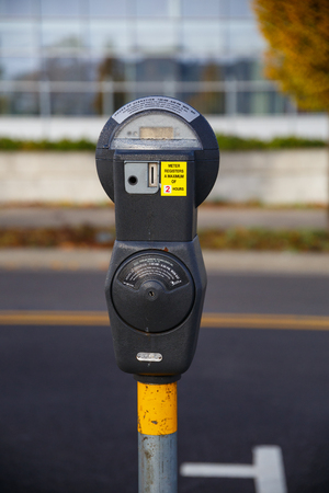 quarters: EUGENE, OR - NOVEMBER 21, 2015: Parking meter accepting quarters only with a two hour limit.
