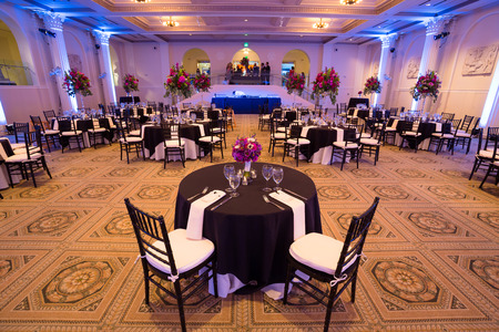hall: PORTLAND, OR - AUGUST 30, 2014: Wedding reception hall setup for guests at the Portland Art Museum sunken ballroom location.