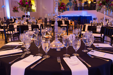 PORTLAND, OR - AUGUST 30, 2014: Wedding reception hall setup for guests at the Portland Art Museum sunken ballroom location.
