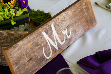 mr and mrs: Wedding sign on a reception table marking the seat for the groom.
