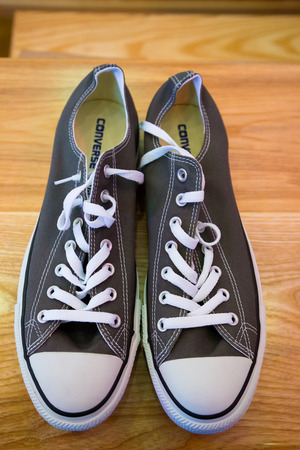converse: EUGENE, OR - SEPTEMBER 20, 2014: Converse All Stars in grey for men to be worn by the groom on his wedding day.