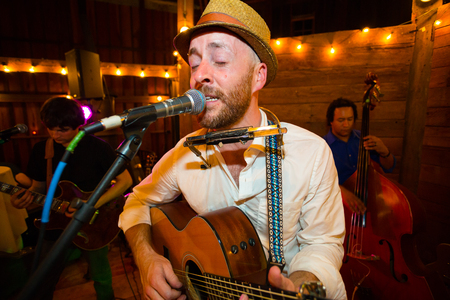 playing folk: HILLSBORO, OR - SEPTEMBER 14, 2014: Will West and his band perform at the Cornelius Pass Roadhouse McMenamins in Hillsboro Oregon.