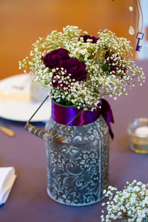 floral decoration: Flowers in a jar at a wedding reception in Oregon.