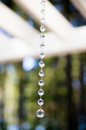 Wedding decorations hang from a pergola to be used in an outdoor stock photo wedding decorations hang from a pergola to be used in an outdoor ceremony junglespirit Images