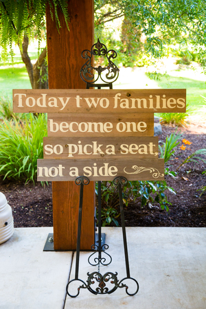 wedding day: Wedding sign reads today two families become one so pick a seat not a side.