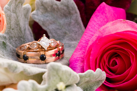vows: Custom made wedding rings for the bride and groom made out of rose gold by a jewelry maker in Portland Oregon.
