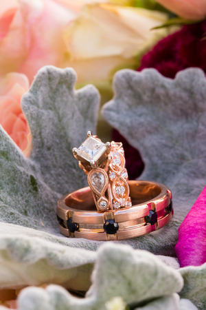 commitment committed: Custom made wedding rings for the bride and groom made out of rose gold by a jewelry maker