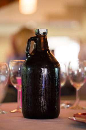 Growler full of craft beer at a wedding reception.