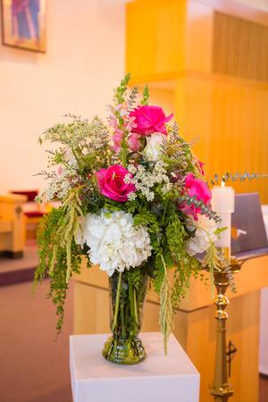 catholic wedding: Flower bouquet at a wedding ceremony inside a Catholic church. Stock Photo