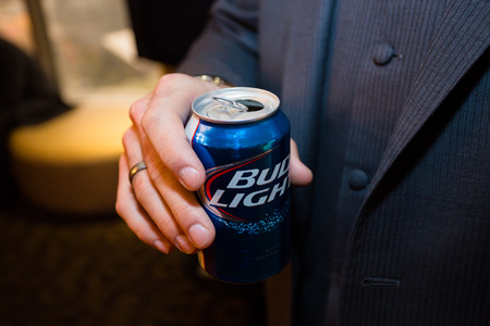 LAS VEGAS, NV - DECEMBER 12, 2014: Bud Light beer in a blue can held by the groom on his wedding day.