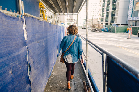 scaffolds: SAN FRANCISCO, CA - DECEMBER 11, 2015: Urban sidewalk under scaffolds in downtown San Francisco. Editorial