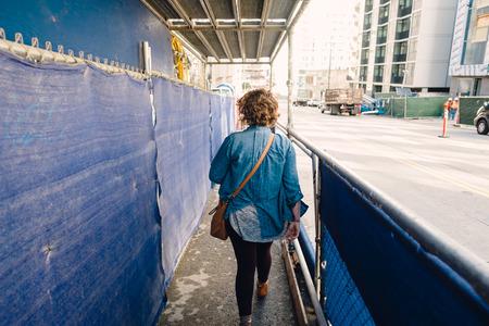 SAN FRANCISCO, CA - DECEMBER 11, 2015: Urban sidewalk under scaffolds in downtown San Francisco. Editorial