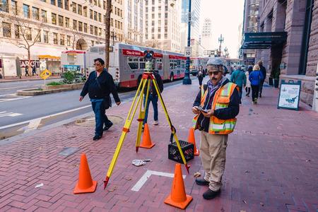SAN FRANCISCO, CA - DECEMBER 11, 2015: Survey worker near a construction site in downtown San Francisco. Editöryel