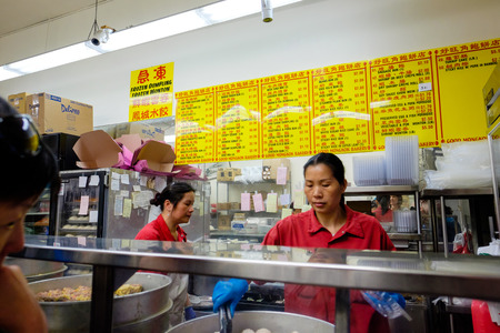 mang: SAN FRANCISCO, CA - DECEMBER 9, 2015: Bakery workers cooking food in Good Mang Kok Bakery in China Town San Francisco.