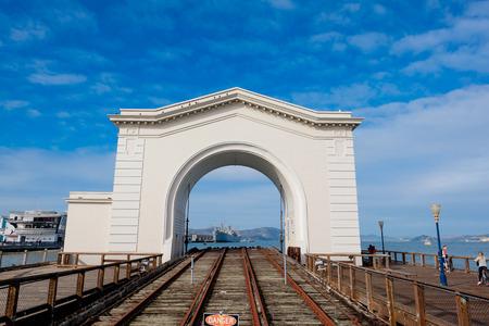 san francisco bay: SAN FRANCISCO, CA - DECEMBER 12, 2015: Navy boat docked along Pier 41 in San Francisco Bay.