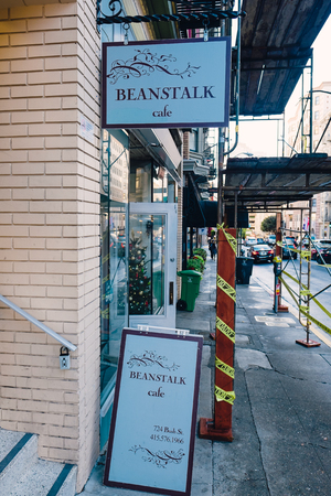 scaffolds: SAN FRANCISCO, CA - DECEMBER 11, 2015: Sign and storefront for the Beanstalk Cafe with scaffolds covering the sidewalk.