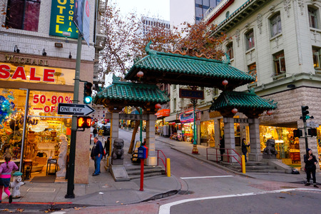 china town: SAN FRANCISCO, CA - DECEMBER 9, 2015: Historic Dragon Gates mark the entrance to China Town in San Francisco California.