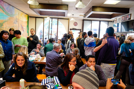 eating area: SAN FRANCISCO, CA - DECEMBER 12, 2015: La Taqueria has won multiple awards for the best burrito in the world. This busy taqueria shop in located in the Mission neighborhood.