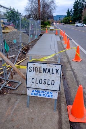 housing development: SPRINGFIELD, OR - DECEMBER 16, 2015: New sidewalk construction in front of a housing development on 5th Street in Springfield Oregon.