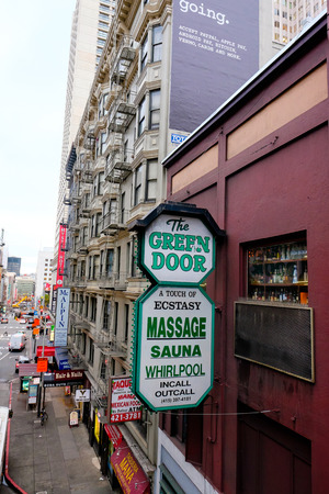 ecstasy: SAN FRANCISCO, CA - DECEMBER 9, 2015: Sign oustide of The Green Door bar and restaurant and A Touch Of Ecstasy Masage.