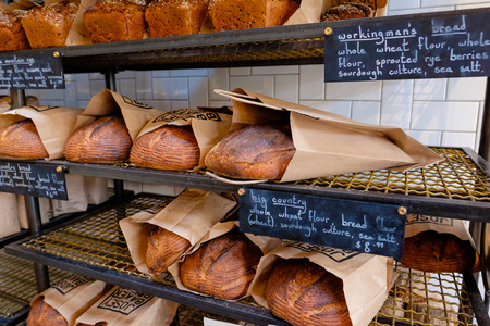 artisan bakery: SAN FRANCISCO, CA - DECEMBER 10, 2015: Artisan bread on shelves for purchase at The Mill, a coffee shop and bakery in San Francisco.