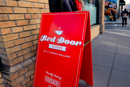 red door: SAN FRANCISCO, CA - DECEMBER 11, 2015: Minna Gallery Red Door Coffee shop serving Fourbarrel coffee in San Francisco.
