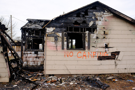 House burned almost completely in a major fire leaving only the damaged remains of this home. Stock Photo