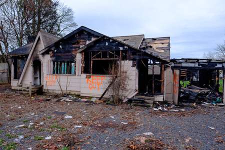 trashed: House burned almost completely in a major fire leaving only the damaged remains of this home. Stock Photo