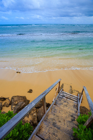 northshore: Stairs lead down to an amazing beach on the North Shore of Oahu Hawaii where guests can rent houses and stay in a tropical paradise for vacation and relaxation. Stock Photo