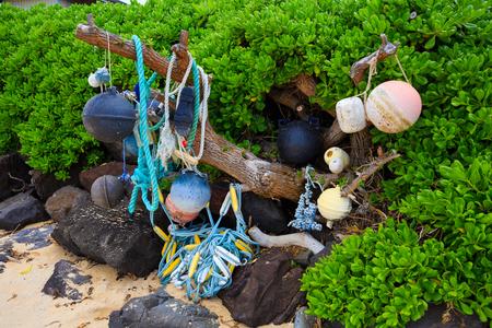 floats: Nautical and marine floats and ropes wash ashore at Bathtub Beach on the North Shore of Oahu Hawaii. Stock Photo