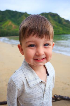 three year old: Portrait of a three year old boy on the beach at Kahana Bay in Oahu Hawaii.