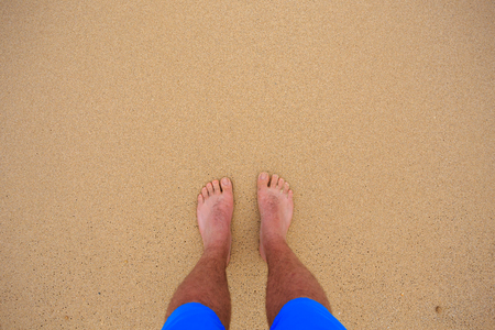 come in: Feet on the beach as the waves come in and out in Oahu Hawaii on the Northshore of this tropical paradise. Stock Photo