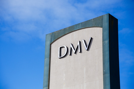 PORTLAND, OR - FEBRUARY 2, 2016: DMV or Department of Motor Vehicles sign against a blue sky.