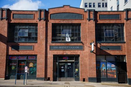 10th: PORTLAND, OR - FEBRUARY 2, 2016: 10th Avenue Liquor Store in Portland Oregon open for business. Editorial