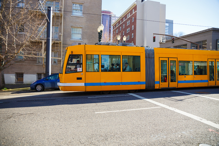 2 way: PORTLAND, OR - FEBRUARY 2, 2016: Portland public transportation Tri-Met street car on a one way street sharing the road with other automobiles.