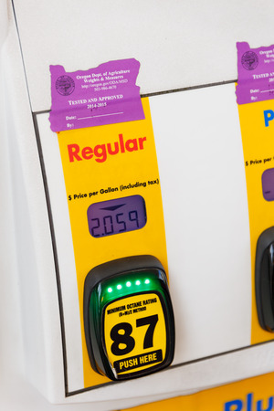 octane: PORTLAND, OR - FEBRUARY 2, 2016: Gas pump octane selection numbers and buttons at a gasoline station in Oregon.