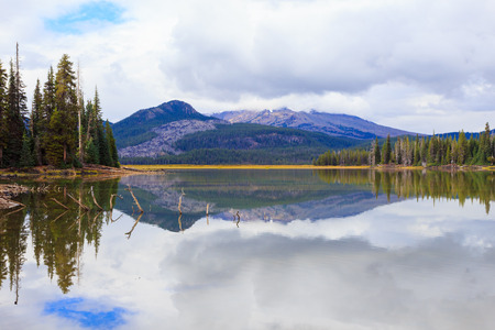 three sisters: Sparks Lake located in the Central Oregon wilderness near the Three Sisters mountains and Broken Top near Bend.