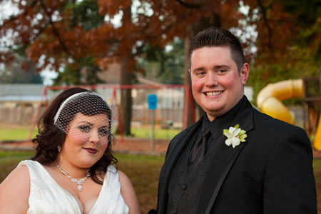 relational: Bride and groom posing for a portrait on their wedding day outdoors in Oregon.