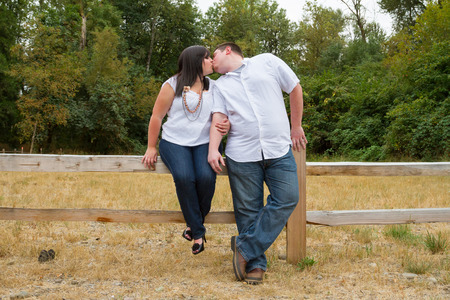 courting: Engaged couple outdoors in a color portrait in Oregon showing the two people are in love.