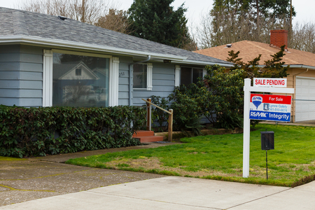 go up: SPRINGFIELD, OR - FEBRUARY 16, 2016: ReMax Integrity listing with a for sale sign is now pending as the real estate market picks up again and prices go up.
