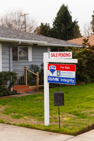 SPRINGFIELD, OR - FEBRUARY 16, 2016: ReMax Integrity listing with a for sale sign is now pending as the real estate market picks up again and prices go up.