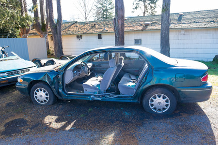 jaws: OAKRIDGE, OR - FEBRUARY 23, 2016: Doors are cut away from this vehicle after the jaws of life were used to rescue the driver seriously injured in an automobile accident.