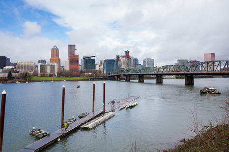willamette: PORTLAND, OR - FEBRUARY 27, 2016: Downtown Portland Oregon seen on a cloudy day from across the Willamette River.