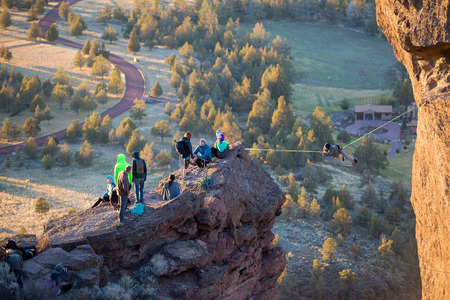 smith rock: SMITH ROCK, OR - FEBRUARY 22, 2016: Highliner on a slackline that stretches between Smith Rock and Monkey Face at the state park in Central Oregon.